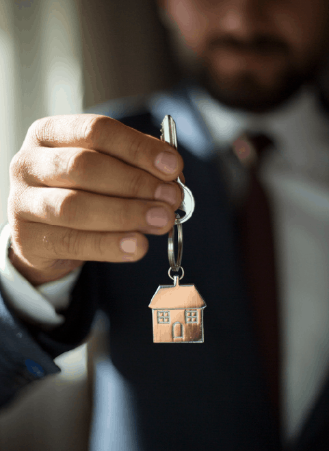 Real Estate Agent Holding Out Key